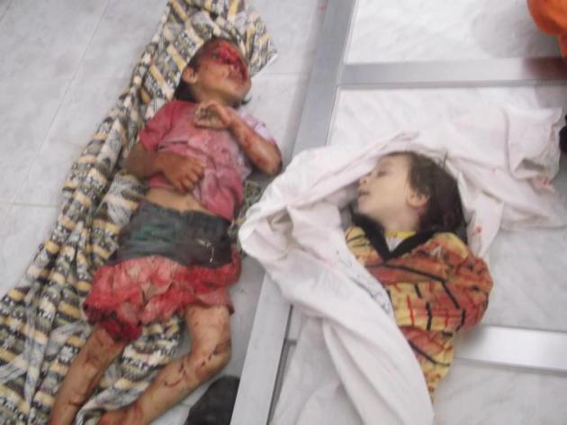 SYRIE: 1261 MORTS DANS LES COMBATS EN UNE SEMAINE ET 19000 EN UN AN ! dans REFLEXIONS PERSONNELLES houla-massacre-syria-91